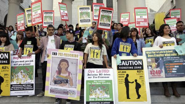 Students rally against truancy policies on the steps of City Hall in Los Angeles on Feb. 22. The city is relaxing its punitive truancy policies to focus on the reasons students skip class.