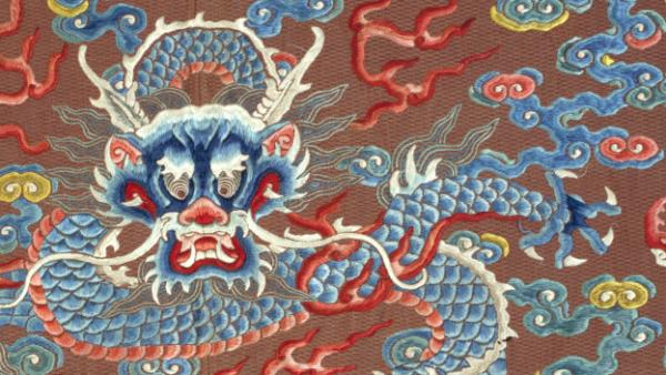 "A close-up of a dragon robe, or <em>long pao</em>, dated late 18th- or early 19th-century China. It's one of many on display in the exhibit ""Dragons, Nagas, and Creatures of the Deep"" at the Textile Museum in Washington, D.C."