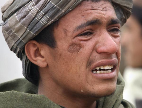 An Afghan youth mourns for relatives who were killed on Sunday.