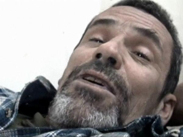 British photographer Paul Conroy lies on a stretcher as he is treated by a doctor in Homs on Feb. 22. Avaaz coordinated Conroy's rescue from the embattled city, an operation that left 13 Syrian activists dead.