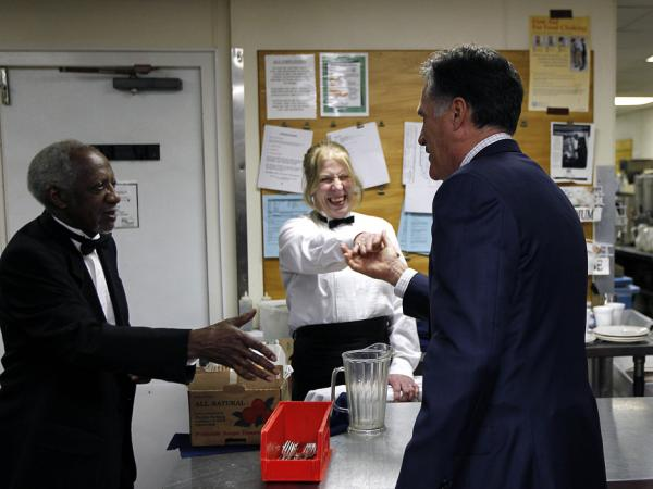 Mitt Romney shakes hands with hotel staffers in the Cleveland suburbs in February.