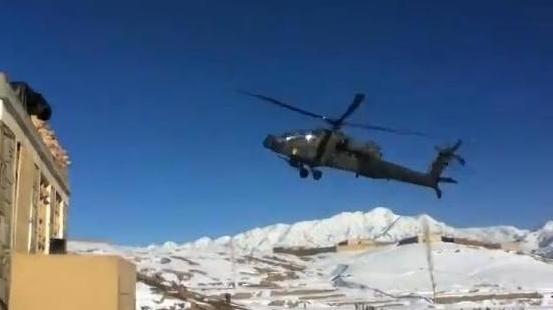 From video of the incident, as the helicopter swooped low over a snowy base in Afghanistan moments before crashing in the distance.