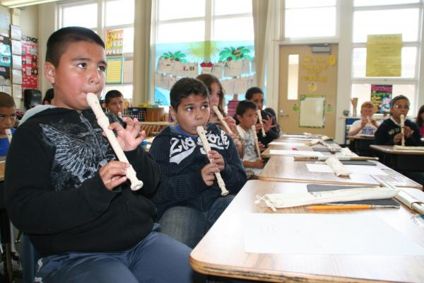 Students play the recorder in Academic Music class at Allen Elementary School in San Bruno, Calif. Teachers are using music notes to teach fractions.