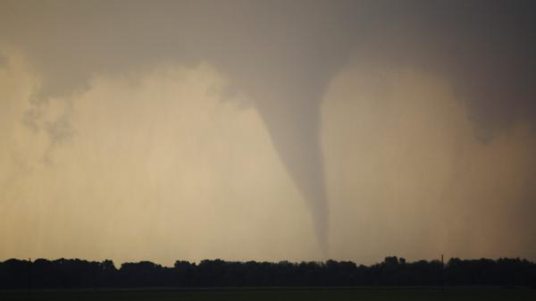 A tornado forms and touches down north of Soloman, Kan., Saturday.