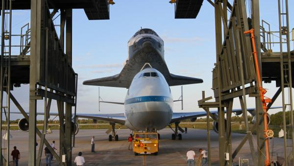 The space shuttle Discovery is loaded onto the back of a modified 747 at Kennedy Space Center on April 15. The plane will ferry the shuttle to Washington, D.C., on April 17, where it will be permanently installed at the Smithsonian National Air and Space Museum.