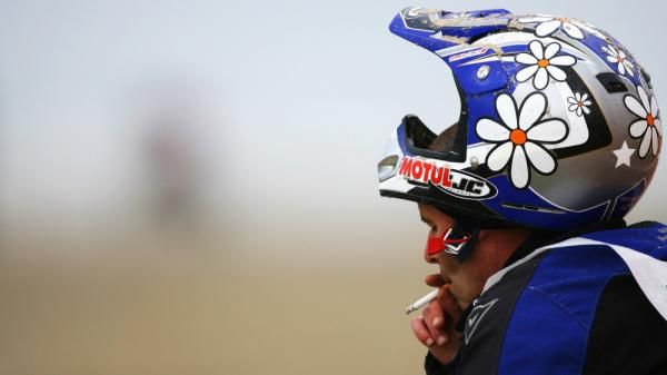 A competitor stops for a cigarette after he broke down during the Enduropale race at Le Touquet Beach on February 22, 2009 in Le Touquet, France.