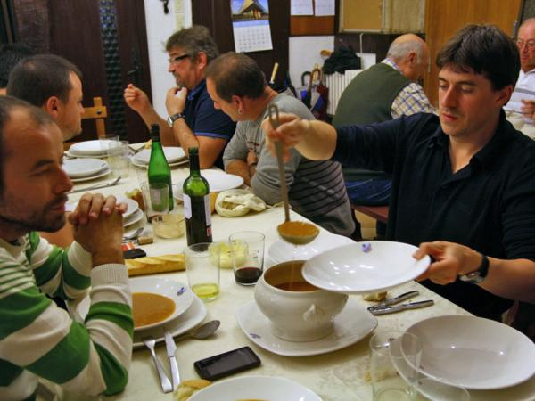 Enrique Vallejo serves soup at the Amaikak Bat <em>txoko</em> in San Sebastian.