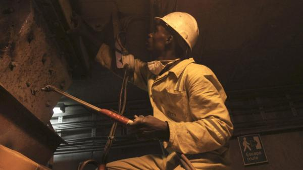 A miner works in the Mimosa Platinum mine in February. A strong mining industry has helped Zimbabwe recover from disastrous economic conditions a few years ago.