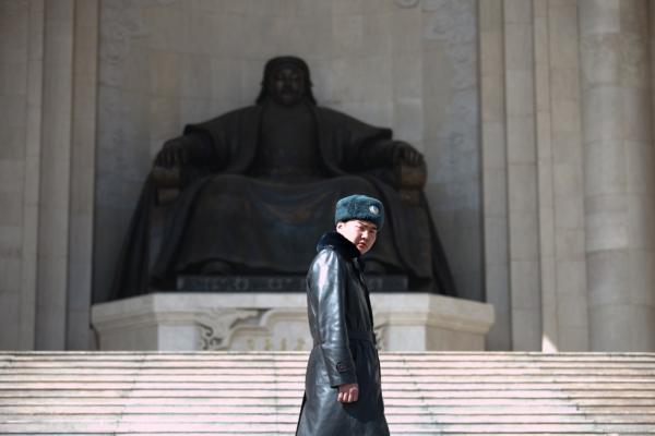 The Central Asian nation of Mongolia is undergoing vast change, thanks to a booming mining industry. A guard in Ulan Bator, the capital, surveys central Sukhbaatar Square; behind him stands a giant statue of Genghis Khan, the country's founder.