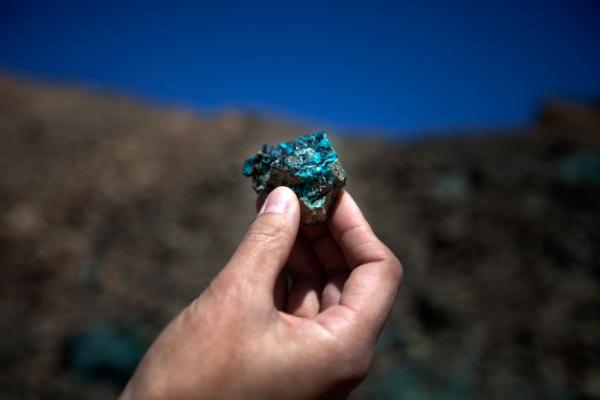 "Oyu Tolgoi, a massive mine in Mongolia's South Gobi province, begins producing copper ore in June, 2012. Within five years, it's expected to become the world's third largest copper mine. An employee at Oyu Tolgoi — which means ""Turquoise Hill"" — holds up a chunk of oxidized copper."