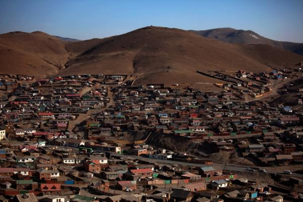 So-called <i>ger</i> villages — actually a mix of yurts and more permanent shelters — spread out onto the hills surrounding Ulan Bator. Some plots are legally purchased; others are occupied by squatters. Most residents have left lives as herders to look for jobs in Mongolia's capital. One-third of Mongolia's population lives in Ulan Bator.