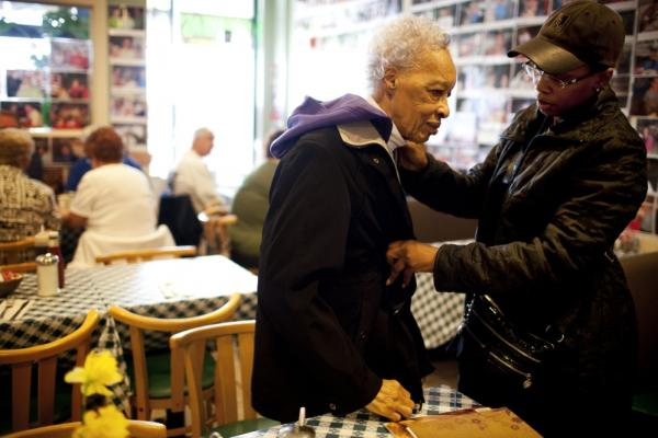 Yolanda zips up Ida's coat after taking her out to breakfast on her 89th birthday.