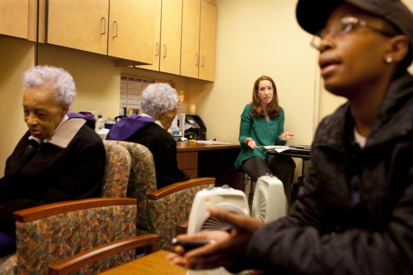 Yolanda speaks to a specialist during one of the many routine doctors' appointments.