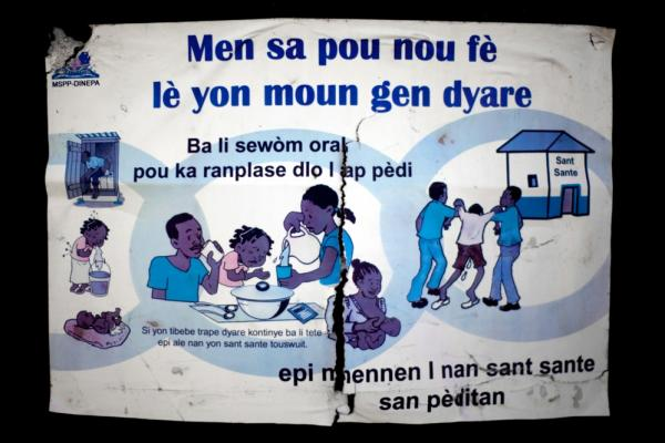 A sign produced by Haiti's water authority warns about the dangers of diarrhea and shows how to treat it — lots of fluids and a trip to a health clinic.