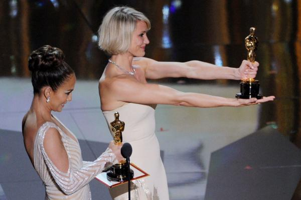 "Presenters Jennifer Lopez (left) and Cameron Diaz present the awards for Best Costume (Mark Bridges, ""The Artist"") and Best Makeup"
