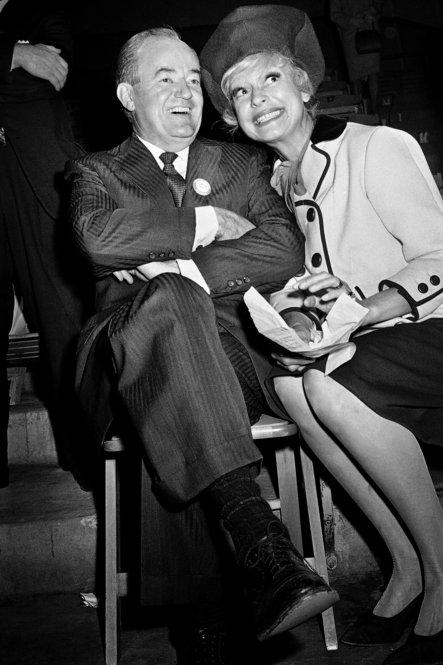 "Before serving under Lyndon B. Johnson, Hubert Humphrey was known as a ""happy warrior"" for liberal causes. Once in office, his silence on such matters earned him criticism from the left. Here he poses with actress Carol Channing in 1964."