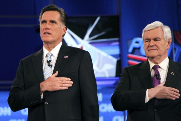 Mitt Romney and Gingrich stand for the national anthem at the Feb. 22 Republican presidential debate in Mesa, Ariz.