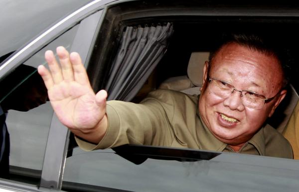 Aug. 24, 2011: Kim Jong Il waves from his car after a meeting with Russian President Dmitry Medvedev in Siberia for secrecy-shrouded talks on energy and food aid.