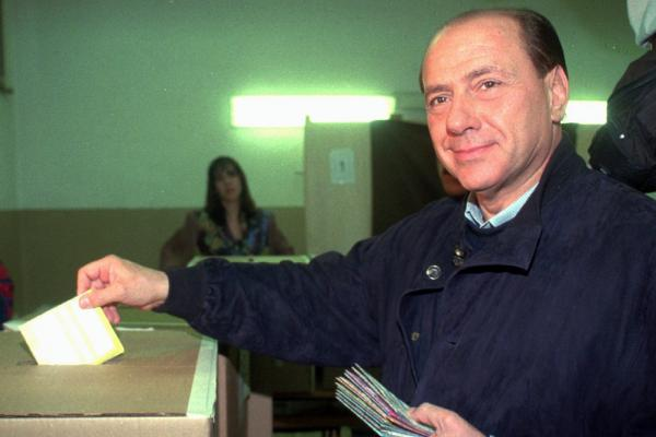 Silvio Berlusconi casts his ballots in the national referendum in Milan in 1995. The outcome of the referendum was decisive in determining the fate of Berlusconi's TV empire.