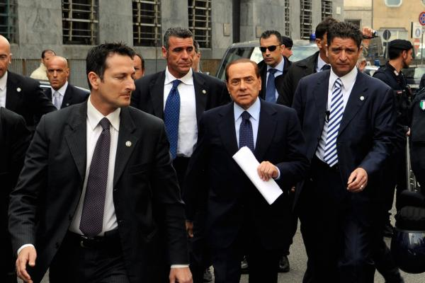 Berlusconi arrives at Milan's justice court before a legal hearing over allegations of fiscal fraud and breach of trust in his business interests, on May 2, 2011.