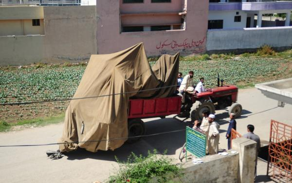 Pakistani army soldiers move a destroyed helicopter from bin Laden's compound in Abbottabad.