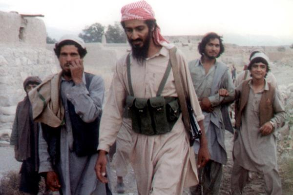 Bin Laden (center) walks with Afghanis in Jalalabad, Afghanistan, in 1989. The news of his death sent the world into celebration and protest.