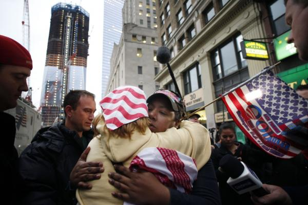 Dionne Layne, facing camera, hugs Mary Power at ground zero in New York on Monday as they react to the news.