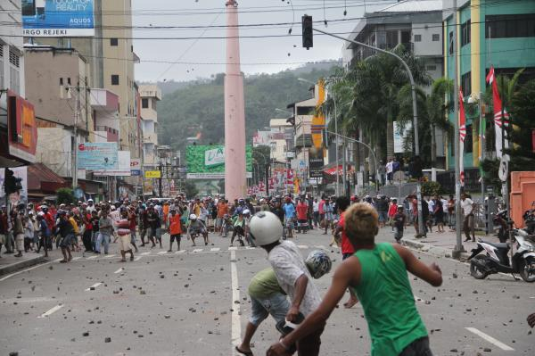 Muslims (in the foreground) face a group of Christians during a bloody clash in Ambon, the provincial capital of Indonesia's Maluku Island, on Sept. 11, 2011. The riot exposed deep fault lines between Christians and Muslims in Indonesia.