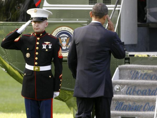 President Obama returns a Marine's salute as he boards the Marine One helicopter Wednesday. Obama traveled to Colorado Springs for the U.S. Air Force Academy graduation ceremony.