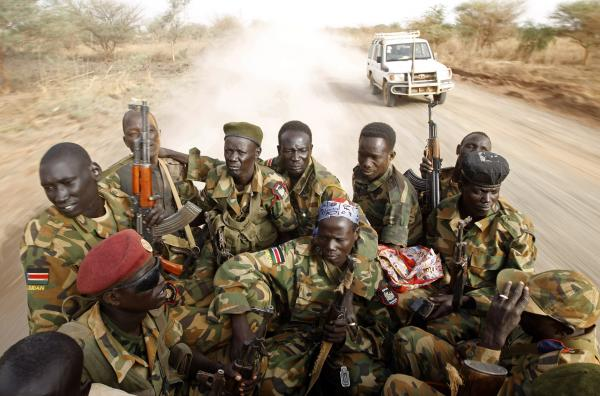 After decades of war, football signals hope. In this photo, South Sudanese soldiers travel by truck near the frontline with Sudan on April 24.
