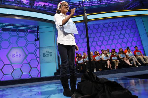 Vanya Shivashankar, 10, of Olathe, Kansas, spells a word during the semifinals on Thursday.
