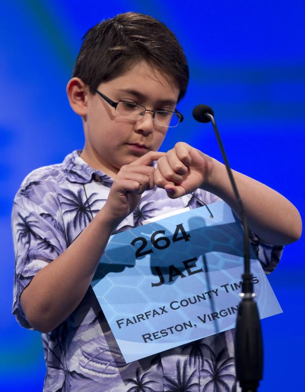 "Jae Canetti of Fairfax, Va., concentrates on his word ""habendum"" during the semifinal round on Thursday."