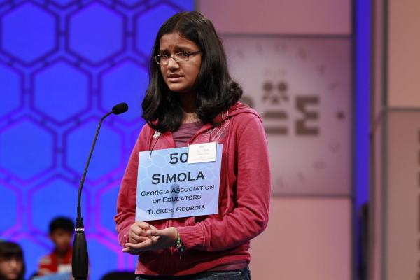 Despite looking nervous, Simola Nayak, 13, of DeKalb County, Ga., spells a word correctly in Round 5 of the semifinals on Thursday.