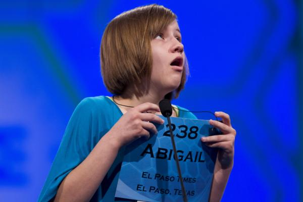 "Abigail Violet Spitzer of El Paso, Texas, reacts after spelling her word ""tondino"" correctly during Thursday's semifinal round."