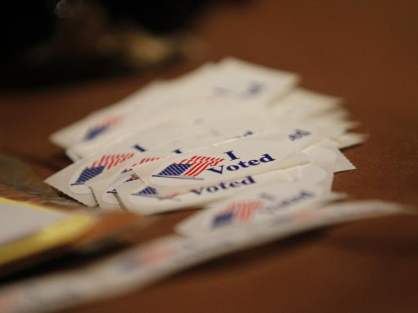 Stickers are given to voters Tuesday in Milwaukee. Wisconsin voters are choosing between Republican Gov. Scott Walker and Democratic challenger Tom Barrett in a recall election.