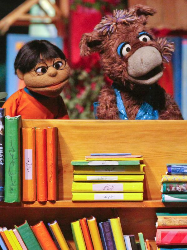 Baily the donkey (right) and Munna, characters from the Pakistani version of <em>Sesame Street</em>, perform at the launch ceremony for the show, <em>Sim Sim Hamara,</em> at Rafi Peer Theater Workshop in Lahore, Nov. 26, 2011.