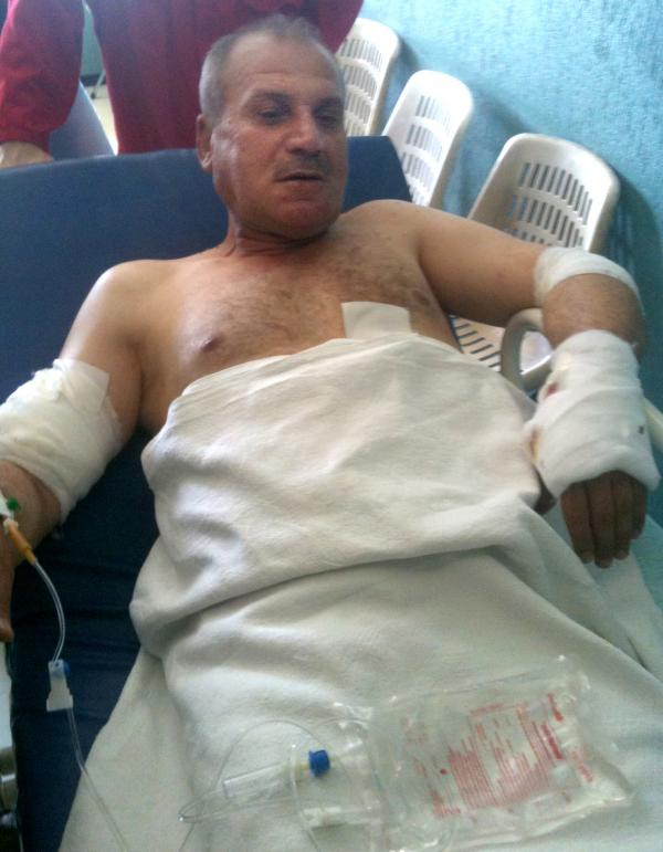 Col. Abdul Kareem Mustapha, 51, is being treated at Barzeh military hospital in Damascus. He was wounded in the Syrian capital Tuesday during an ambush by armed men in taxis that killed one of his fellow passengers.