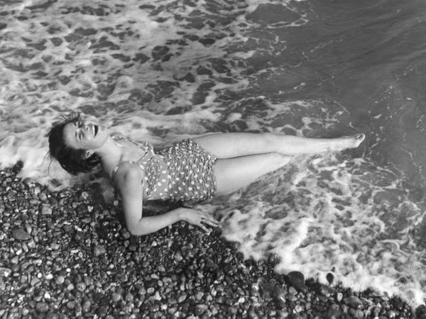 Yvonne Lockyer in her bathing costume in 1952, looking as if she just washed up on the beach.