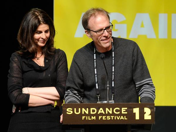 Producer Amy Ziering and Director Kirby Dick accept an award at this year's Sundance Film Festival for their documentary <em>The Invisible War</em>, which looks at sex crimes in the military.