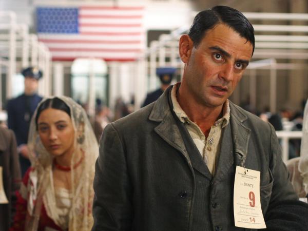 Salvatore Mancuso (Vincenzo Amato) arrives at Ellis Island with his family in <em>Golden Door.</em>