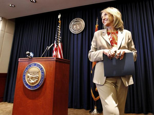 "Arizona Republican Gov. Jan Brewer leaves a podium at the state Capitol in Phoenix after responding to President Obama's immigration speech on June 15. Brewer said the speech represented a ""pre-emptive strike"" aimed at what then was an upcoming Supreme Court ruling on Arizona's immigration law."