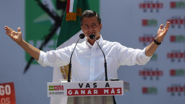 PRI candidate Enrique Pena Nieto campaigns in Mexico City. Pena Nieto is heavily favored in Mexico's presidential election on Sunday. He says his party, which has been out of power for 12 years after ruling for seven decades, has changed its ways.