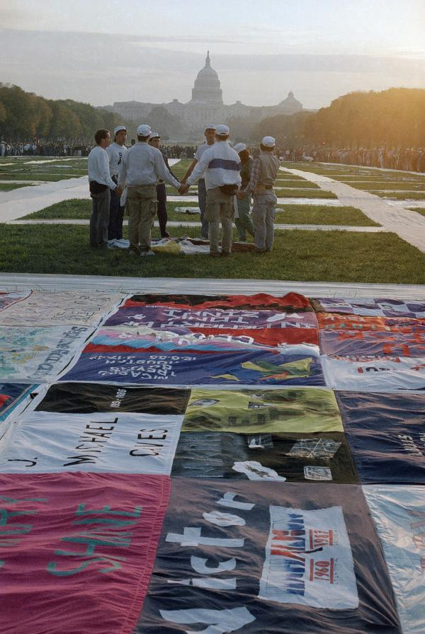 A sunrise ceremony is held in 1987 in Washington, near part of the quilt bearing the names of people who have died of AIDS.