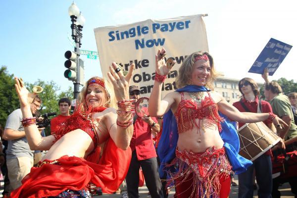Two supporters of the law belly-dance as they demonstrate in front of the Supreme Court.