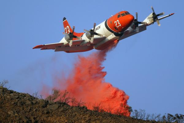 A firefighting air tanker drops fire retardant on the Tea Fire in Montecito, Calif. in 2008. In 2000, The U.S. Forest Service had contracts for 43 air tankers. These days, that number is only nine.