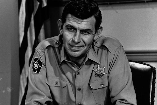 Actor Andy Griffith died Tuesday at 86. He sits in uniform, as Sheriff Andy Taylor, on the set of his television series <em>The Andy Griffith Show</em> in 1967.