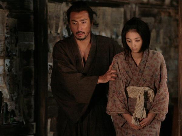 Hanshiro and Miho (Hikari Mitsushima) in one of the many flashbacks that director Takashi Miike uses to unfold the plot in <em>Hara-Kiri: Death of a Samurai</em>.