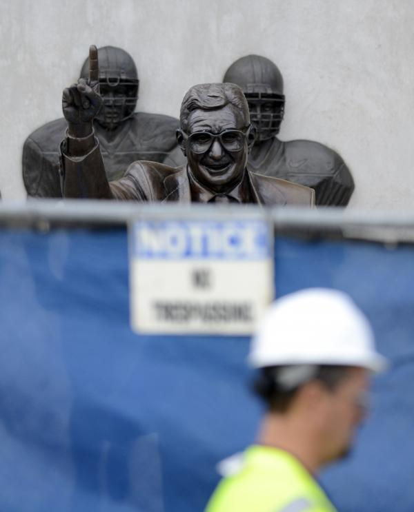 The famed statue of Joe Paterno was taken down from outside the Penn State football stadium Sunday after top officials were accused in a scathing report of burying child sex-abuse allegations against a now-convicted retired assistant.