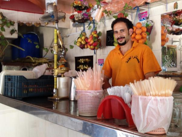 Mohamed Godb works at Paradise Juices in a Cairo suburb. One way Egyptians are trying to beat the heat this Ramadan season is breaking the fast by drinking fresh juice.