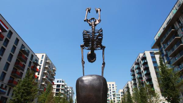 This sculpture of a skeletal gymnast stands in London's Olympic Village, where athletes are preparing for today's Opening Ceremony. If you think it's weird, you're not alone.